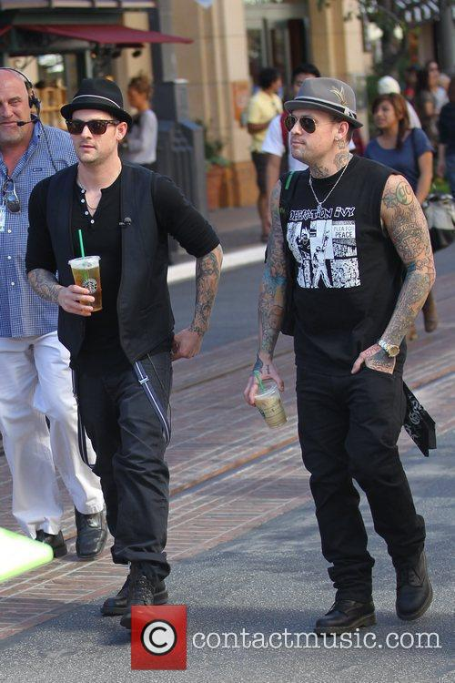 Good Charlotte brothers drinking Starbucks beverages at The...