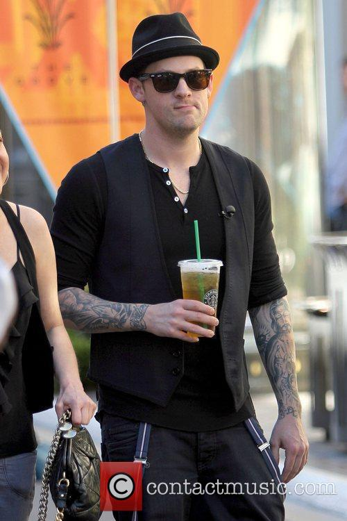 Joel Madden drinking a Starbucks beverage Good Charlotte...
