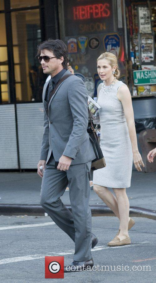 Matthew Settle and Kelly Rutherford on location with...