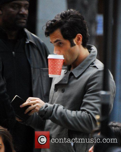 Penn Badgley filming on location on the set...