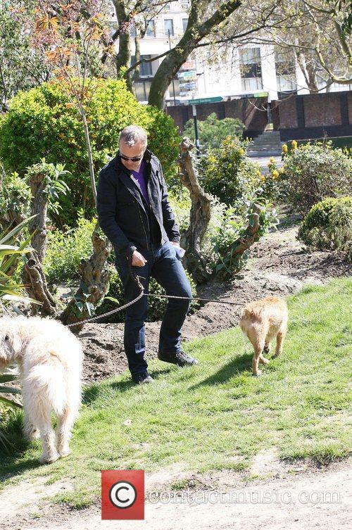Walking his dogs on the south bank