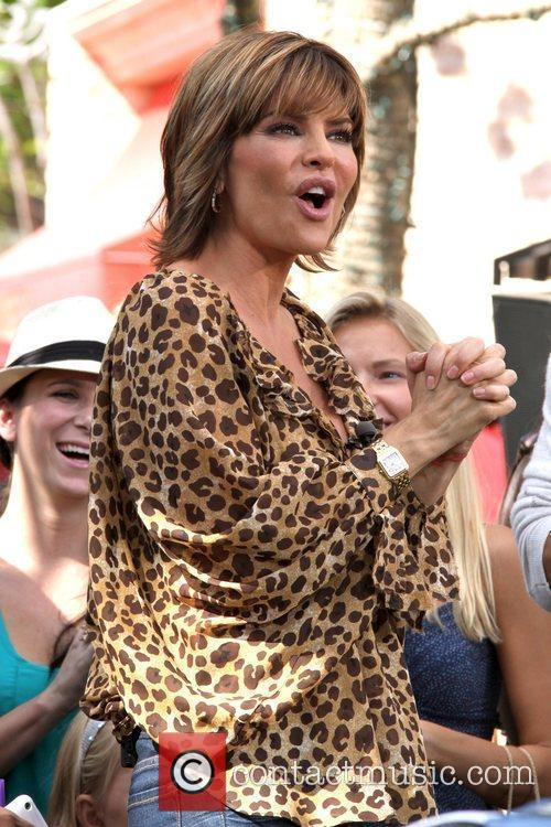 Lisa Rinna filming an interview for the entertainment...