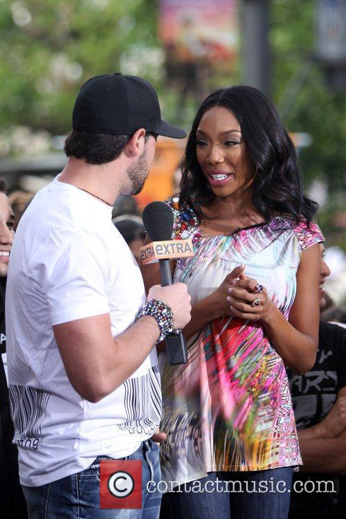 Maksim Chernovsky and Brandy Norwood during an interview...