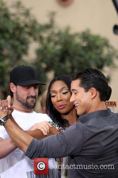 Maksim Chernovsky, Brandy Norwood and Mario Lopez during...