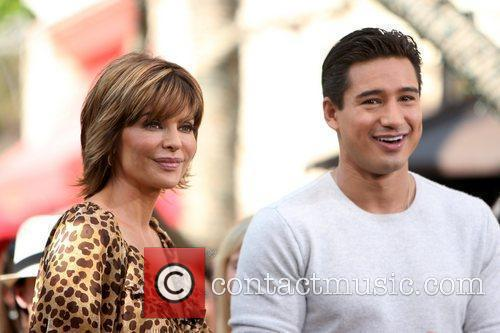 Lisa Rinna filming an interview with Mario Lopez...