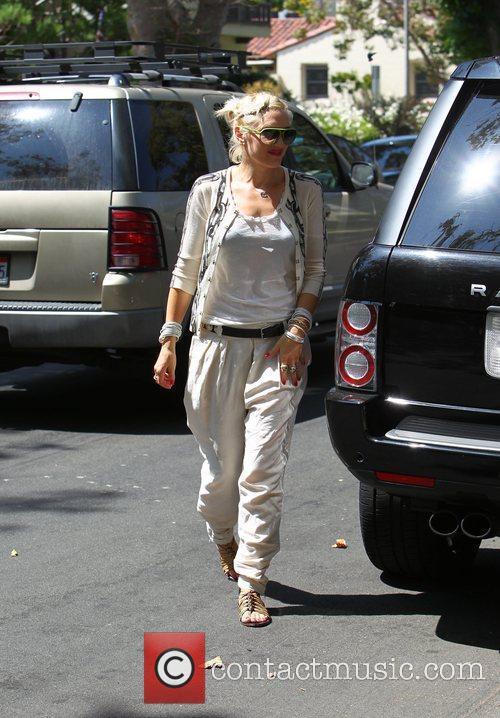 Gwen Stefani returns to her car after visiting...