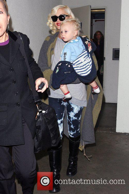Gwen Stefani carries her son, Zuma, as they...