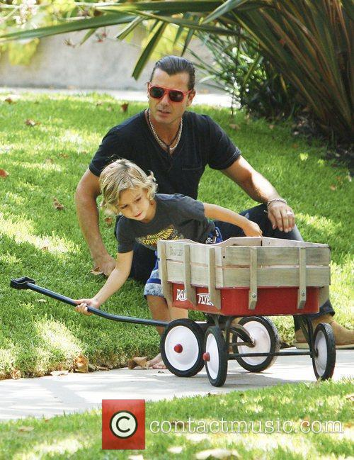 Gavin Rossdale plays with his son Kingston outside...