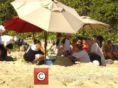 Gwen Stefani on holiday at Gouverneur beach with...