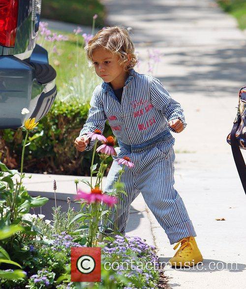 Kingston Rossdale chasing butterflies while out walking with...