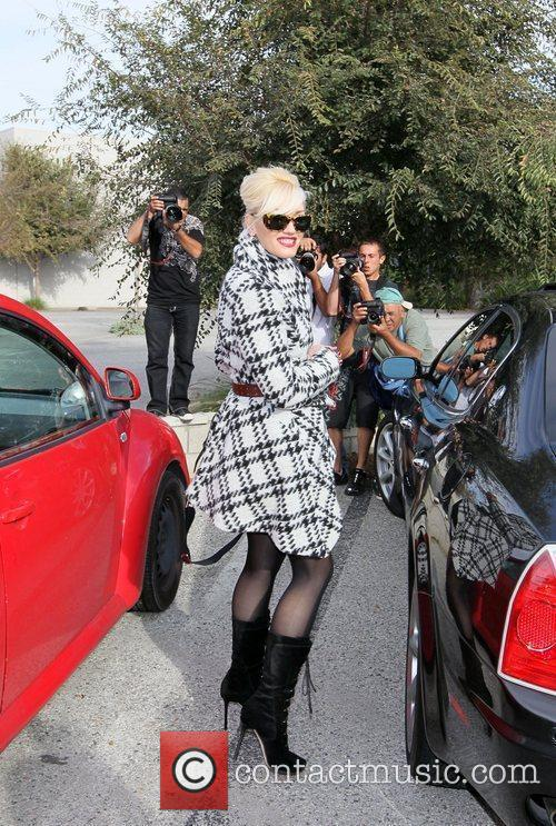 Gwen Stefani poses for photographers after attending a...