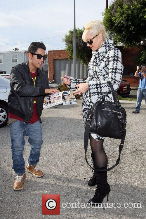Gwen Stefani signs an autograph for a fan...