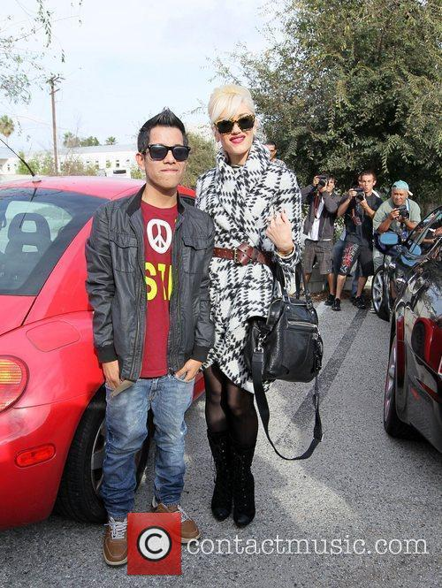 Gwen Stefani poses for a photo with a...