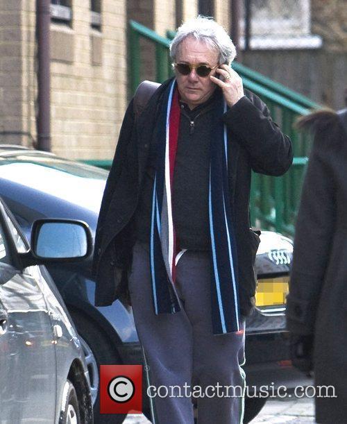 Producer Trevor Horn arrives at the recording studio...