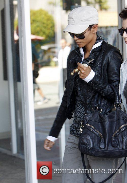 Halle Berry runs errands with a friend on...