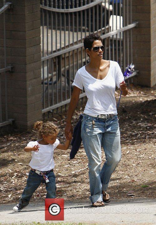 Actress Halle Berry dresses her daughter Nahla in...