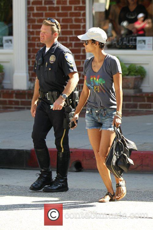 Halle Berry  is escorted by Police Officers...