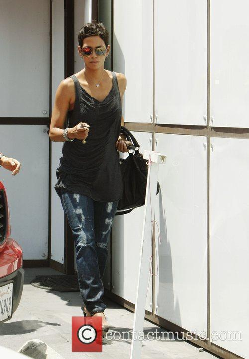 Halle Berry stops by at The Hair Shop,...