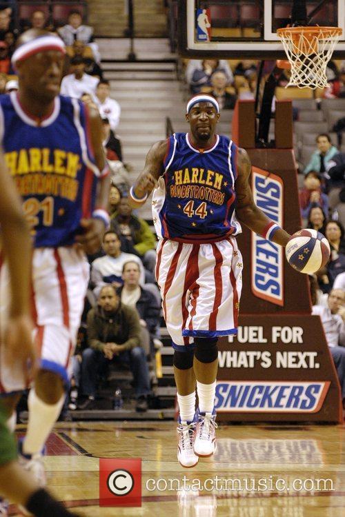 Harlem Globetrotters playing on the court at The...