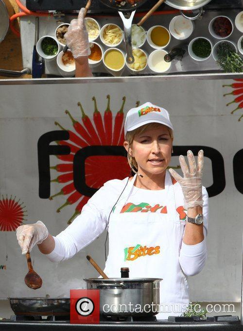 Heather Mills does a cooking demonstration outside a...