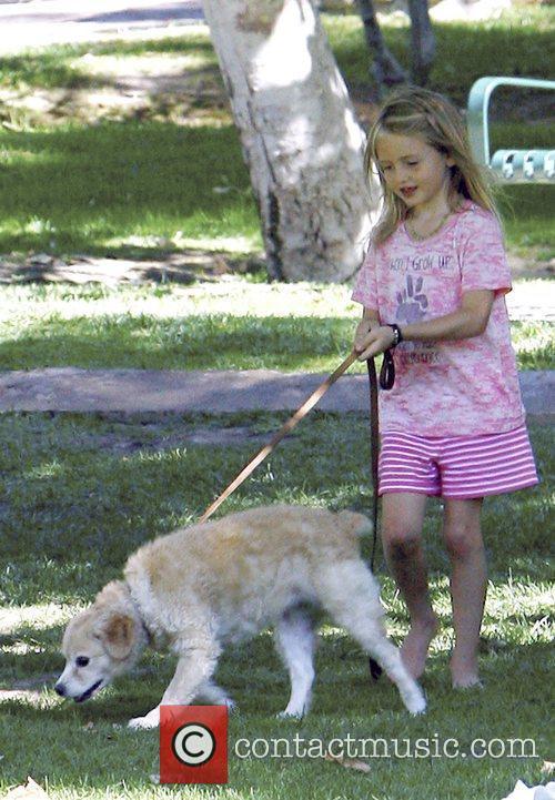 Heidi Klum's daughter Leni walking her puppy dog...