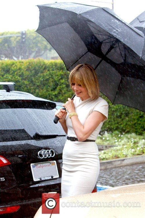 Heidi Klum and Holding A Large Black Umbrella 9