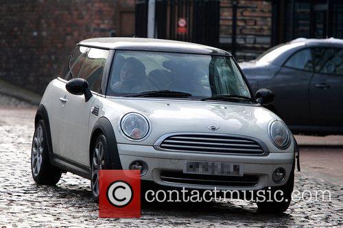 Helen Flanagan leaving a studio, driving a Mini...