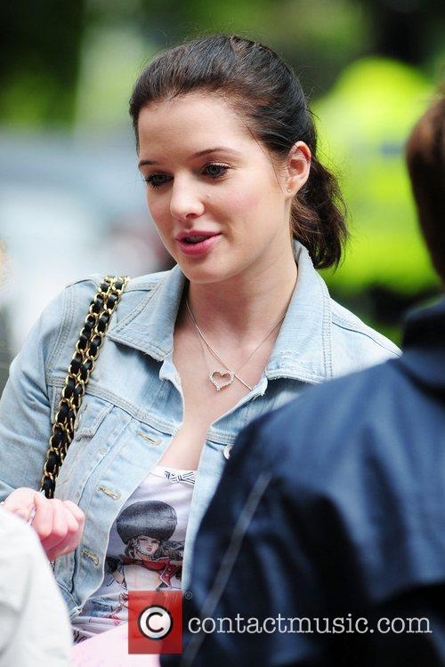 Returns to the 'Coronation Street' set after shopping...