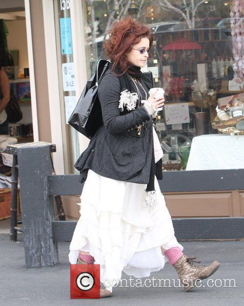 Helena Bonham Carter frinking coffee while out and...