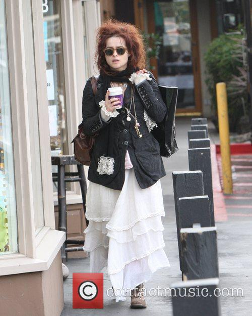 Helena Bonham Carter drinking coffee while out and...