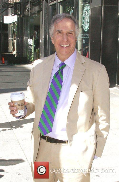 Henry Winkler departs Starbucks after getting a coffee....