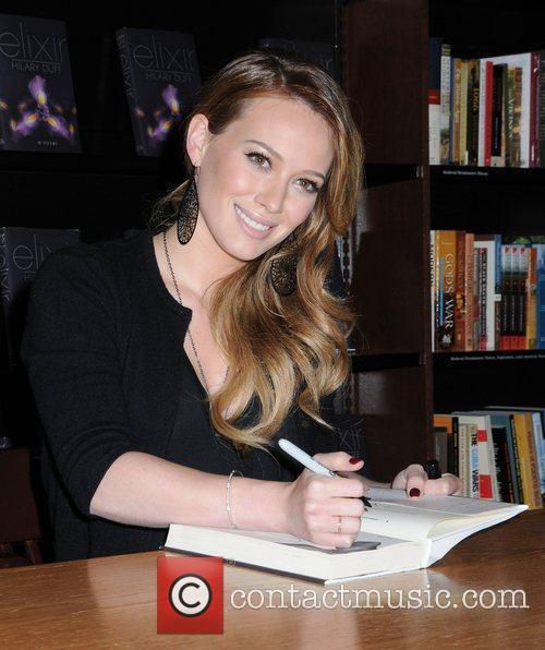 Hilary Duff signing copies of her book 'Elixir'...