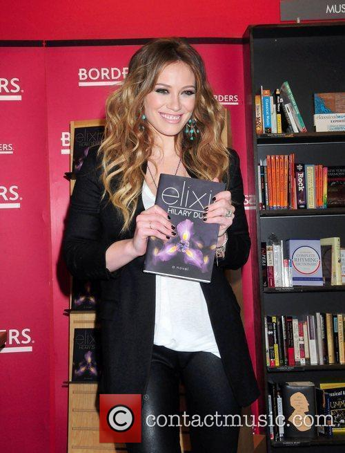 Actress/singer, signs copies of her new book 'Elixir'...
