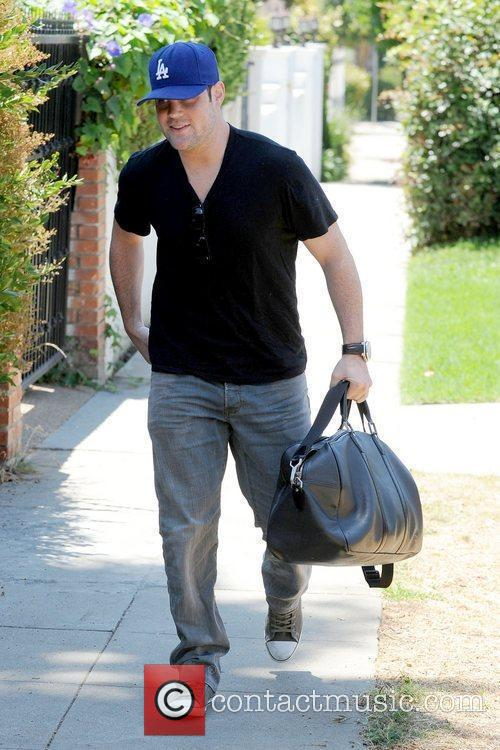 Arriving at his personal trainer's house in West...