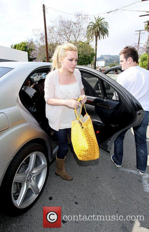 Hilary Duff, Her Fiance, Mike Comrie, A Canadian Professional Ice Hockey Player and Are Dropped Off At Hillary's Mercedes Suv After Being Taken To Look At Furniture By A Salesman. 7