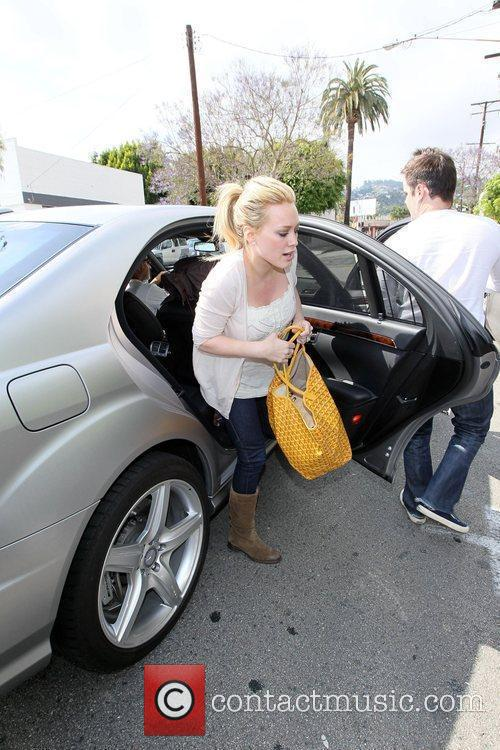 Hilary Duff, Her Fiance, Mike Comrie, A Canadian Professional Ice Hockey Player and Are Dropped Off At Hillary's Mercedes Suv After Being Taken To Look At Furniture By A Salesman. 9