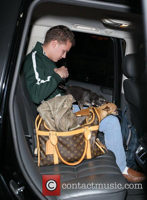 Barron Hilton and The Family Dogs Arrive At Lax 4