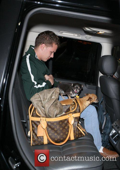 Barron Hilton and The Family Dogs Arrive At Lax 3
