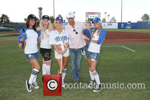 Holly Madison throws the ceremonial first pitch at...