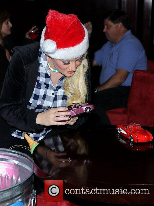 Continues her Holly Jolly Toy Drive at Platinum...