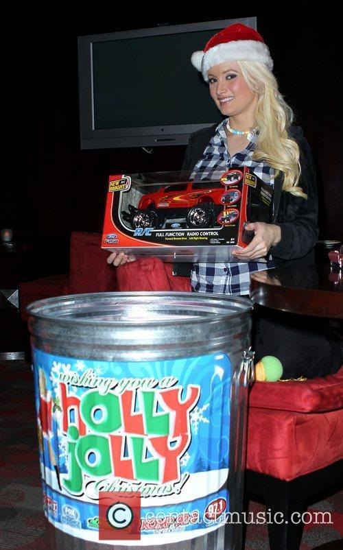Holly Madison  continues her Holly Jolly Toy...