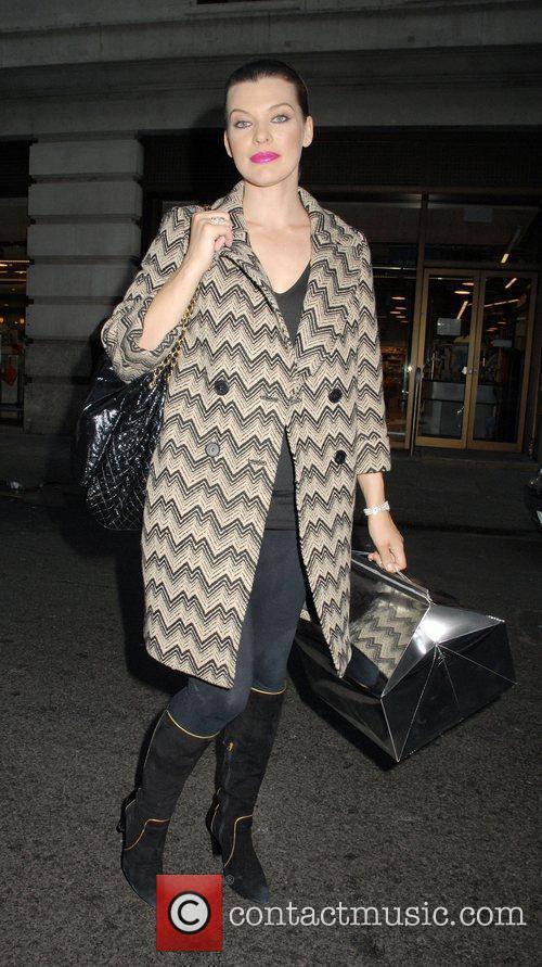 Outside her London hotel