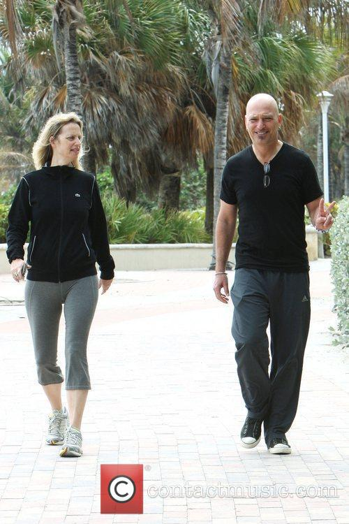 Takes a walk along Miami Beach with his...