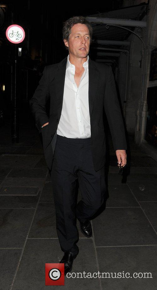Hugh Grant leaving J Sheekey restaurant, with a...