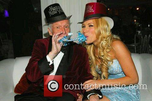Hugh Hefner celebrates the New Year with his...