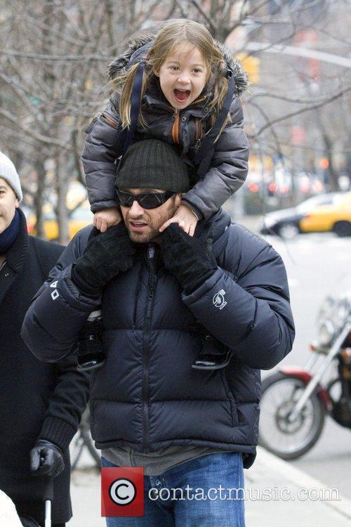 Hugh Jackman carries his daughter Ava Eliot Jackman...