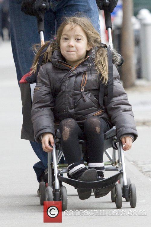 Hugh Jackman pushes his daughter Ava Eliot Jackman...