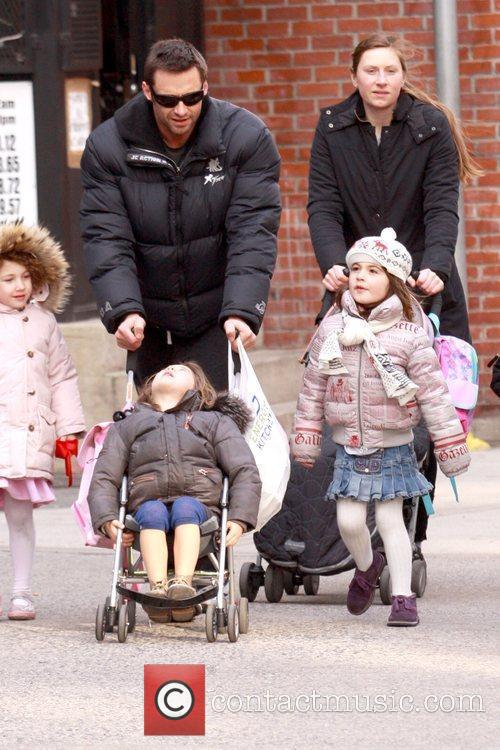 Hugh Jackman walking in Soho with his family...