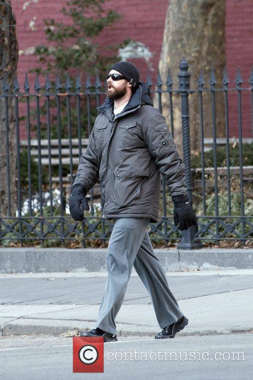 Hugh Jackman along with his family walk their...