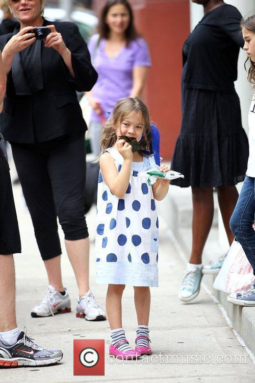 Ava Jackman enjoys a snack after school New...